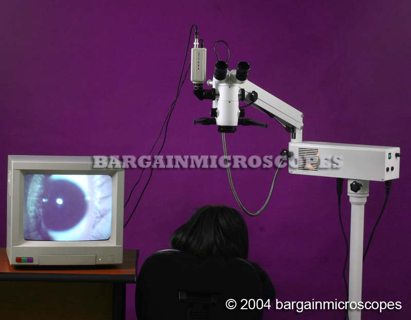 OPHTHALMIC SURGICAL MICROSCOPE&nbsp;ARTICULATING MOBILE FLOOR STAND&nbsp;5.3x-8x-12x SELECTABLE POWER&nbsp;INCLINED BINOCULAR HEAD&nbsp;MOTORIZED FOOT CONTROL FOCUSING